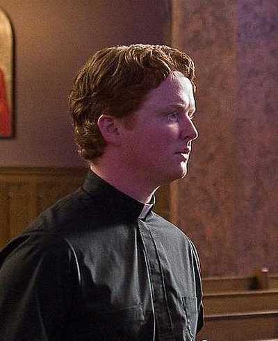 4Christopher Carley as Father Janovich