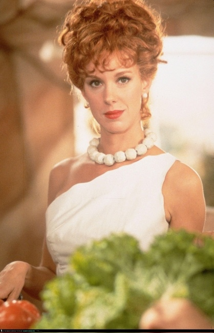 Elizabeth Perkins as Wilma Flintstone